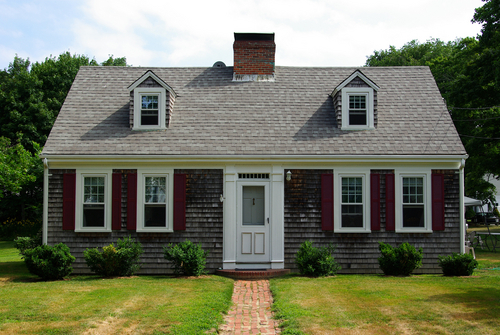 Metal roof metal roof cape cod home for How much does it cost to dormer a cape